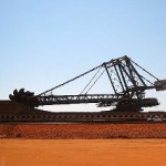 Iron ore falls again as ex Rio boss warns of more volatility
