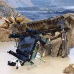 Investigation continues after dozer falls into water-filled hole