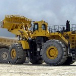 Komatsu cuts profit target as mining demand drops