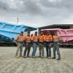 Giant dump truck trays painted pink and blue for cancer awareness