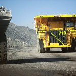 Truck crashes through windrow, rolls down dump at Rio Tinto coal mine