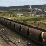 Truck crashes into coal train