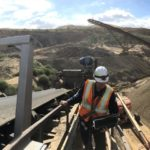Measuring rock flow on a conveyor belt