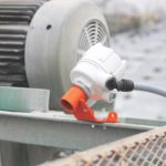 Optimise conveyor belt cleaner tension to maximise performance and life